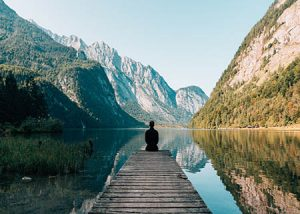 Sitting alone in nature for reflection and mindfulness